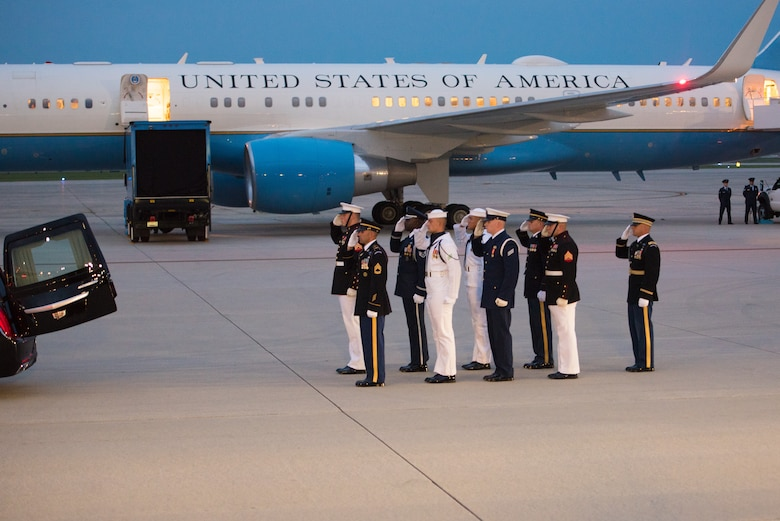 Members of the Joint Service Arrival Team salute the casket of Sen. John McCain following it's arrival at Joint Base Andrews, Md., Aug. 30, 2018. The former senator's remains are en route to lie in state in the U.S. Capitol Rotunda. (U.S. Air Force photo by Airman 1st Class Jalene Brooks)