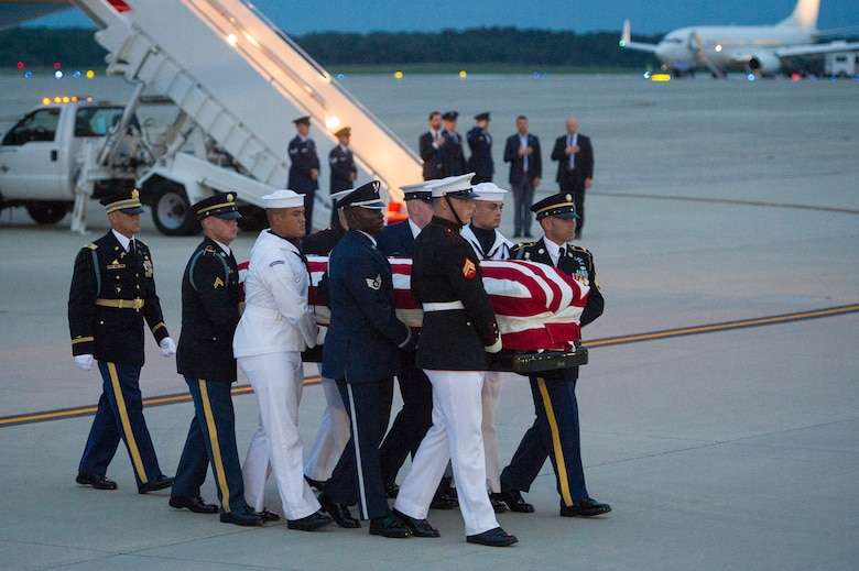 Members of the Joint Service Arrival Team carry the casket of Sen. John McCain at Joint Base Andrews, Md., Aug. 30, 2018. DoD personnel are honoring the former senator, and retired Navy Captain, by providing ceremonial support to his congressional funeral events. (U.S. Air Force photo by Master Sgt. Michael B. Keller)