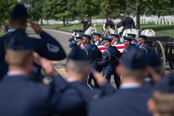 Airmen with the 732nd Airlift Squadron with the 514th Air Mobility Wing, render a salute to the casket of Floyd Carter Sr., who was laid to rest at Arlington National Cemetery, Va., Aug. 22, 2018.