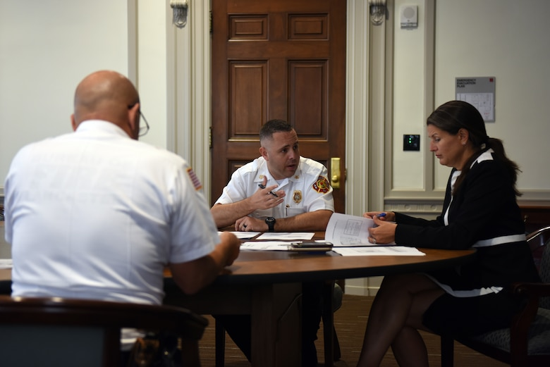 Scott Little, center, fire chief of Lancaster's Bureau of Fire, and David Amico, deputy chief of Lancaster's Bureau of Fire, meet with Lancaster's Mayor Danene Sorace to discuss the possible addition and remodeling of firehouses as well as improving their fire rescue service delivery Aug. 21, 2018, Lancaster, Pennsylvania. The meeting resulted in Sorace approving a budget of up to 10 million dollars for this specific project. (U.S. Air National Guard photo by Senior Airman Julia Sorber/Released)