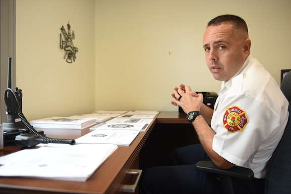 Scott Little, fire chief of Lancaster's Bureau of Fire, explains various policies and programs that he is working on implementing at the bureau Aug. 21, 2018, Lancaster, Pennsylvania. Little has plans for a number of outreach initiatives, including a citizens' fire academy, a community engagement program and a youth mentorship program for middle school and high school students. (U.S. Air National Guard photo by Senior Airman Julia Sorber/Released)