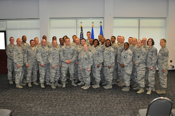 Attendees from the Additional Duty First Sergeant Symposium, pose for a group photo at Dobbins Air Reserve Base, Georgia, Aug. 5, 2018. More than 20 Master and Technical Sergeants from the 94th Airlift Wing attended the event to learn about the duties and responsibilities of being a first sergeant, or an additional duty first sergeant. (U.S. Air Force photo/Master Sgt. James Branch)