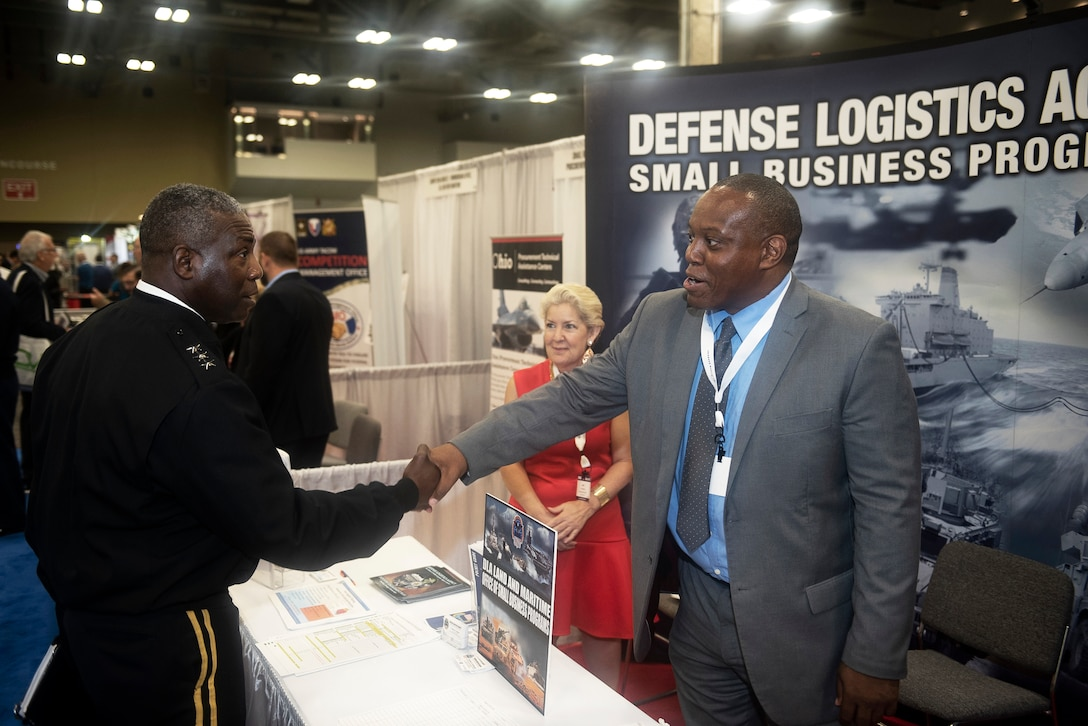 Defense Logistics Agency Director Army Lt. Gen. Darrell K. Williams greets members of the DLA Land and Maritime Small Business Office Earl Madison and Ami Banks during a visit to the exhibition hall June 19 shortly after his keynote address to kick off the 2018 DLA Land and Maritime Supplier Conference and Exposition in downtown Columbus, Ohio.
