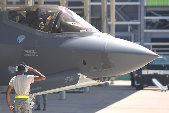 Airman Jarret Smith, 388th Aircraft Maintenance Squadron, and a pilot from the 4th Fighter Squadron, exchange salutes before a training sortie, Aug. 8, 2018, Hill Air Force Base, Utah. Airmen and F-35s from the active-duty 388th Fighter Wing and Reserve 419th Fighter Wing at Hill AFB participated in the Air Force's Weapon System Evaluation Program known as Combat Hammer. (U.S. Air Force photo by Todd Cromar)
