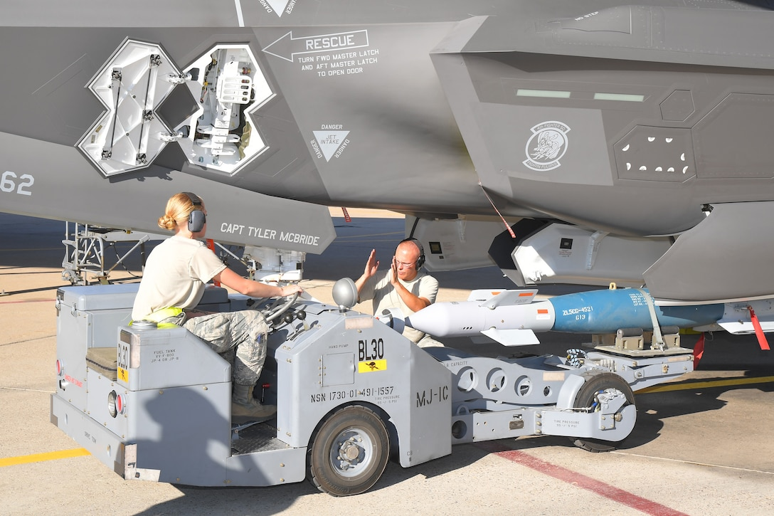 (Left to right) Airman 1st Class Kayla Lewis and Staff Sgt. Adam Selmon, 388th Aircraft Maintenance Squadron, load target munitions on an F-35A Lightning II Aug. 8, 2018, at Hill Air Force Base, Utah. Airmen and F-35s from the active-duty 388th Fighter Wing and Reserve 419th Fighter Wing at Hill AFB participated in the Air Force's Weapon System Evaluation Program known as Combat Hammer. (U.S. Air Force photo by Todd Cromar)