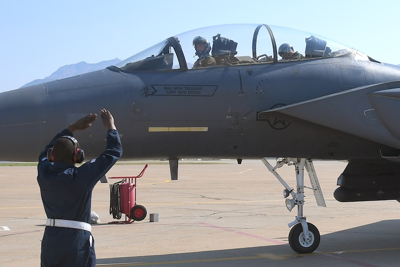 Senior Airman Deandre Moment, 389th Fighter Squadron, directs an F-15E Strike Eagle returning from a training mission Aug. 15, 2018, at Hill Air Force Base, Utah. The 389th FS at Mountain Home Air Force Base, Idaho, were at Hill AFB to participate in the Air Force's Weapons System Evaluation Program known as Combat Hammer. (U.S. Air Force photo by Todd Cromar)   (U.S. Air Force photo by Todd Cromar)