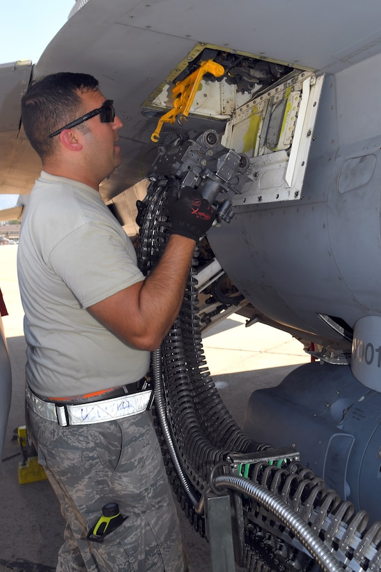 Staff Sgt. Richard Montalvan, 482nd Aircraft Maintenance Squadron, loads target rounds on an F-16, Aug. 8, 2018, at Hill Air Force Base, Utah. The 482nd AMXS from Homestead Air Reserve Base, Fla., was at Hill AFB to participate in the Air Force's Weapon System Evaluation Program known as Combat Hammer. (U.S. Air Force photo by Todd Cromar)