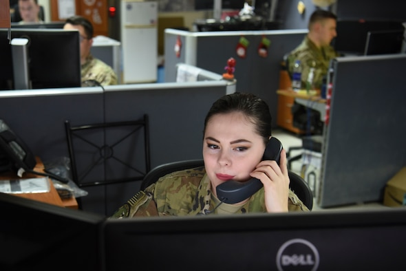Senior Airman Christi Combs, 380th Expeditionary Communications Squadron communications focal point technician, answers a call about a ticket in the communications focal point, Nov. 28, 2018 at Al Dhafra Air Base, United Arab Emirates.