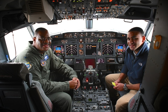 "Colonel Esteban ""Esty"" Ramirez, the outgoing vice commander of the 932d Airlift Wing, sits in the cockpit with his son Nic Esteban, following his last C-40 flight at the 932nd Airlift Wing, Nov. 4, 2018, at Scott Air Force Base, Ill. He will be transferring to the U.S Transportation Command shortly.  During his time with the Illinois unit, Col. Esteban served at various times in roles as both the wing commander and the vice commander.  The wing flies the C-40C aircraft and is the premier distinguished visitor airlift operation in the Air Force Reserve Command. With over 1,000 members, the wing equips trains and organizes a ready force of Citizen Airmen to support and maintain all facets of air base operations involving infrastructure and security. (U.S. Air Force photo by Lt. Col. Stan Paregien)"