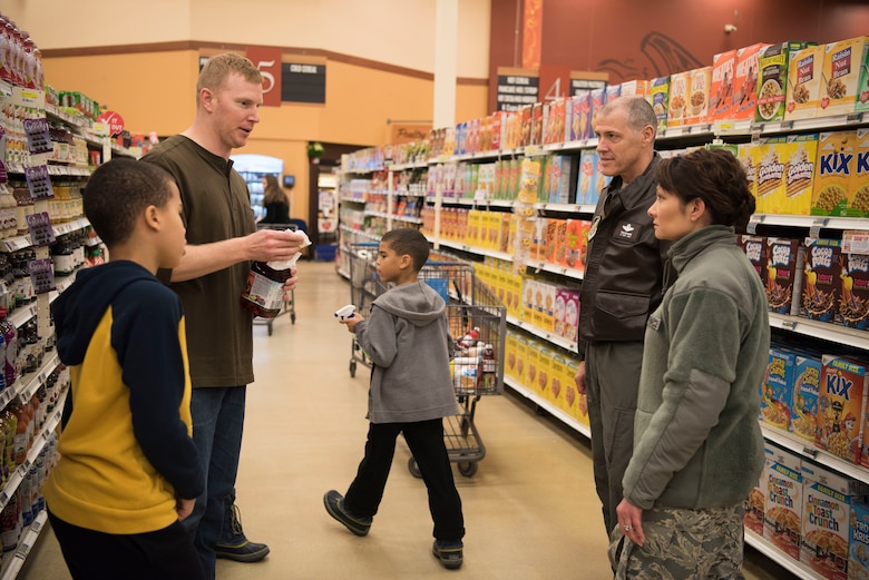 Air Force Lt. Gen. Tom Bussiere, Commander of Alaskan North American Aerospace Defense Command, Alaskan Command, and the Eleventh Air Force, and 673d Air Base Wing Commander Col. Patricia A. Csànk, speak with volunteers at the Joint Base Elmendorf-Richardson, Alaska, Commissary Dec. 1, 2018. In less than 48 hours after the 7.0 magnitude Earthquake striking the Anchorage area at 8:29 a.m. the morning of Nov.30, 2018, JBER is mission ready and capable of resuming regular operations.