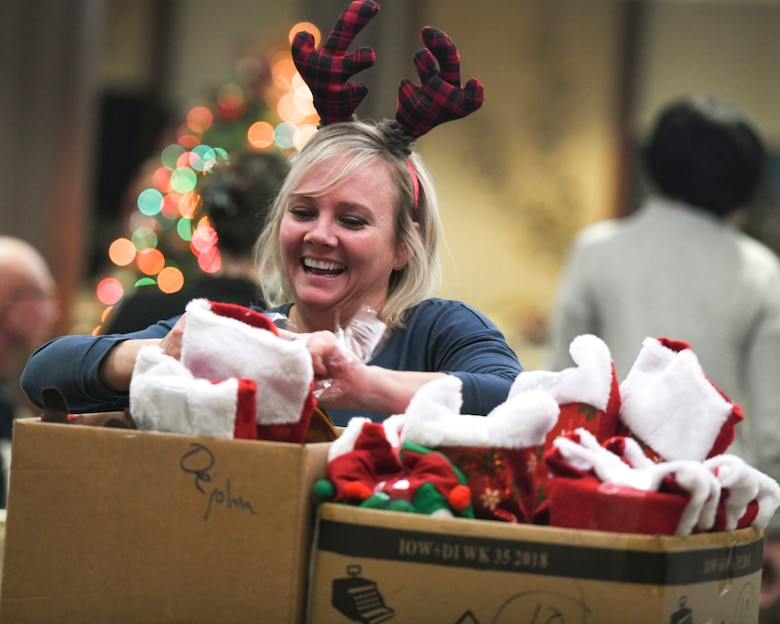 The 910th Airlift Wing's Key Spouses and other volunteers stuffed stockings and made Christmas decorations for Airmen deployed over the holiday season on Nov. 30, 2018, in the Community Activity Center at Youngstown Air Reserve Station.