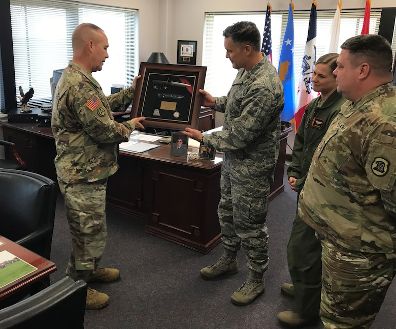 Maj. Mark Williams, 132d Intelligence Surveillance Reconnaissance Group, presents a WWI trench knife to Maj. Gen. Timothy Orr, adjutant general of Iowa, November 20, 2018, at Joint Force Headquarters in Johnston, Iowa. It was presented to commemorate the 100th anniversary of World War I. (U.S. Air National Guard photo by Staff Sgt. Michael J. Kelly)