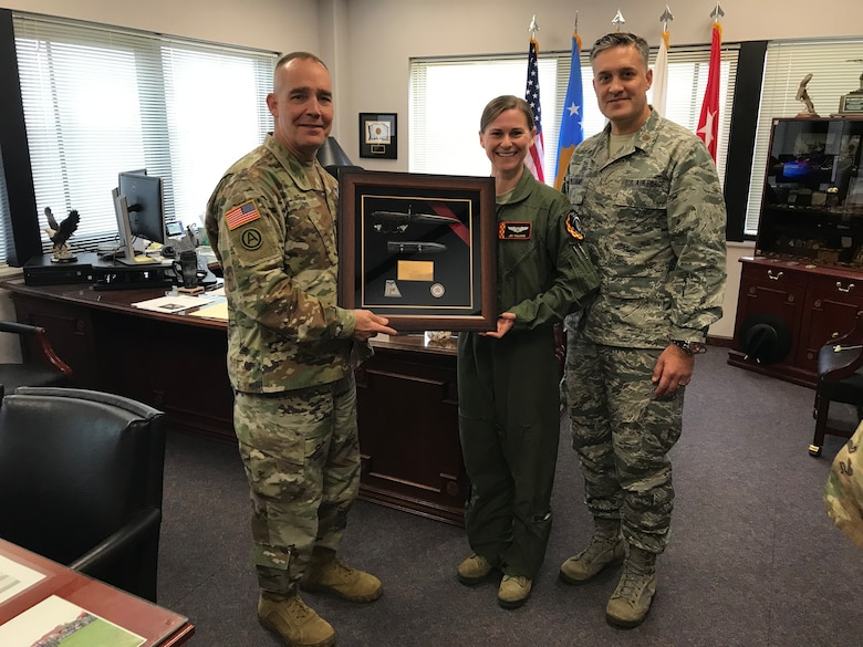 Maj. Mark Williams (far right), 132d Intelligence Surveillance Reconnaissance Group, and Maj. Jen Williams, JFHQ, present a WWI trench knife to Maj. Gen. Timothy Orr (left), adjutant general of Iowa, November 20, 2018, at Joint Force Headquarters in Johnston, Iowa. It was presented to commemorate the 100th anniversary of World War I. (U.S. Air National Guard photo by Staff Sgt. Michael J. Kelly)