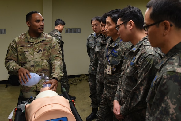 Staff Sgt. Mitchell Harkley, an independent duty medical technician with the 36th Fighter Squadron at Osan Air Base, Republic of Korea, demonstrates how to provide self-aid buddy care response to ROK airmen during trauma care training at Gimhae Hospital, Gimhae Air Base, ROK, Nov. 29, 2018. U.S. Air Force medics joined their counterparts from the ROK Air Force and Army to hold the first ever joint training on trauma care. (U.S. Air Force photo by Staff Sgt. Sergio A. Gamboa)