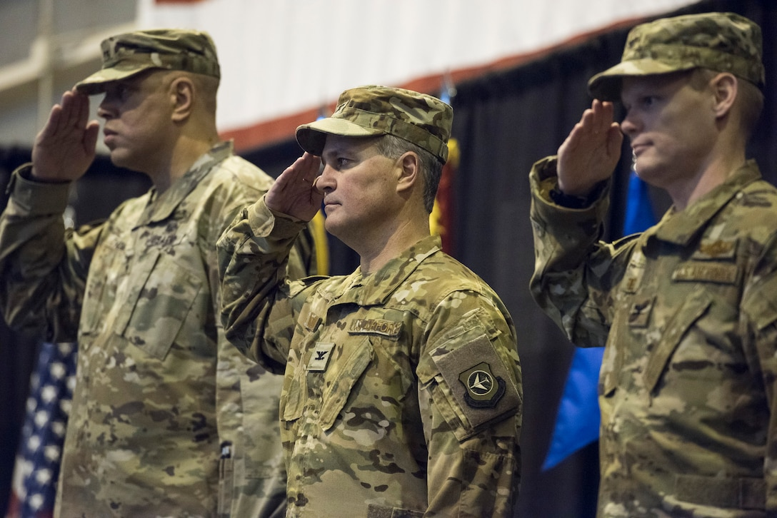 U.S. Army Maj. Gen. Michael C. Thompson, Oklahoma Adjutant General, U.S. Air Force Col. Devin R. Wooden, outgoing commander of the 137th Special Operations Wing, and incoming commander Col. Daniel R. Fowler, 137th SOW, salute during the national anthem at the beginning of the change of command ceremony at Will Rogers Air National Guard Base, Okla., Dec. 1, 2018. Fowler is the 17th commander of the Wing it its history and is only the second wing commander since coversion to a special operations wing in 2015. (U.S. Air National Guard photo by Tech. Sgt. Caroline Essex/Released)