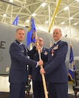 Maj. Gen. Randall A. Ogden, 4th Air Force commander, takes the guidon from Col. Eric Vitosh, outgoing 931st Air Refueling Wing commander, during a change of command ceremony Dec. 1, 2018, McConnell Air Force Base, Kan.  Vitosh, a Traditional Reservist, has commanded the 931st for more than a year.  (U.S. Air Force photo by Tech. Sgt. Abigail Klein)