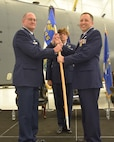 Maj. Gen. Randall A. Ogden, 4th Air Force commander, hands the guidon to Col. Phil Heseltine, incoming 931st Air Refueling Wing commander, during a change of command ceremony Dec. 1, 2018, McConnell Air Force Base, Kan.  Prior to joining the 931st, Heseltine was the vice commander of the 22nd Air Refueling Wing, the active duty component at Team McConnell.  Heseltine is the first colonel to retire from the active duty to join the Air Force Reserve as a wing commander. (U.S. Air Force photo by Tech. Sgt. Abigail Klein)