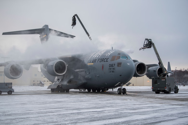 U.S. Air Force Airmen with the 732nd Aircraft Mobility Squadron deices a C-17 Globemaster III at Joint Base Elmendorf-Richardson, Alaska, Dec. 1, 2018. JBER mission operations continue following a 7.0 earthquake hit to Anchorage, Alaska, on Nov. 30.