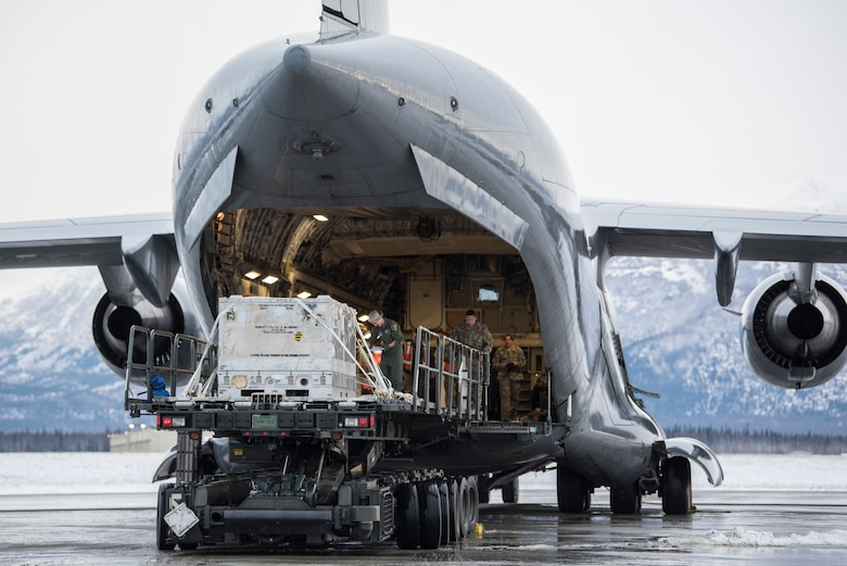U.S. Air Force Airmen with the 732nd Aircraft Mobility Squadron unload cargo onto a C-17 Globemaster III at Joint Base Elmendorf-Richardson, Alaska, Dec. 1, 2018. JBER mission operations continue following a 7.0 earthquake hit to Anchorage, Alaska, on Nov. 30.