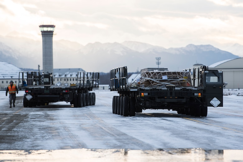 A k-loader containing cargo waits prior to offloading onto a C-17 Globemaster III at Joint Base Elmendorf-Richardson, Alaska, Dec. 1, 2018. JBER mission operations continue following a 7.0 earthquake hit to Anchorage, Alaska, on Nov. 30.