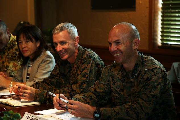 Marine Col. Vincent Ciuccoli, left, and Marine Col. David Steele listen during a meeting Nov. 29 at Terra Restaurant aboard Camp Foster, Okinawa, Japan.