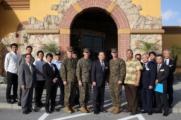 Leadership from Camp Foster, Marine Corps Air Station Futenma and the Ginowan City Mayor and his staff pose for a photo Nov. 29 at Terra Restaurant aboard Camp Foster, Okinawa, Japan.
