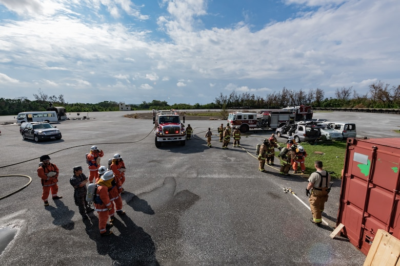 U.S. Air Force firefighters from the 18th Civil Engineer Squadron and Japan Air Self Defense Force firefighters from the 9th Wing, Naha Air Base, Japan, conduct structural live fire training Nov. 15, 2018, at Kadena Air Base, Japan. Firefighters conduct training regularly to maintain constant readiness for emergencies. (U.S. Air Force photo by Staff Sgt. Micaiah Anthony)