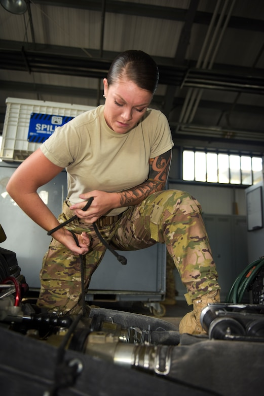 U.S. Air Force Senior Airman Tori Watts, 100th Logistics Readiness Squadron fuels distribution driver and 67th Special Operations Squadron Forward Arming and Refueling Point team member, packs a fuel hose for a FARP mission at RAF Mildenhall, England, Oct. 11, 2018. FARP is a specialty within the fuels career field where members selected to the team are certified to establish refueling sites and refuel airframes in austere locations. (U.S. Air Force photo by Airman 1st Class Alexandria Lee)