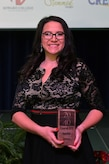 """Jennifer Jensen, one of two Goodfellow spouses awarded, poses with her award after being recognized as one of San Angelo's """"20 under 40"""" at the C.J. Davidson Conference Center in San Angelo, Texas, Nov. 30, 2018. Jensen works at West Texas Counseling and Guidance using her experience as an Air Force veteran to be able to better help those in the community. (U.S. Air Force photo by Airman 1st Class Zachary Chapman/Released)"""
