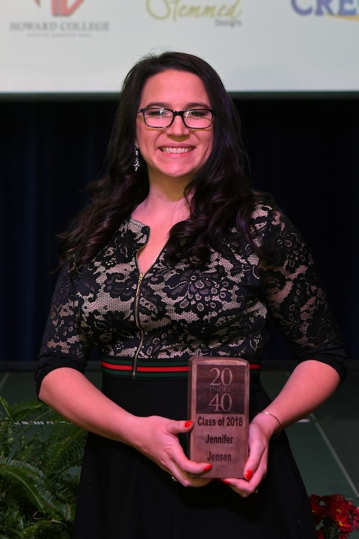 "Jennifer Jensen, one of two Goodfellow spouses awarded, poses with her award after being recognized as one of San Angelo's ""20 under 40"" at the C.J. Davidson Conference Center in San Angelo, Texas, Nov. 30, 2018. Jensen works at West Texas Counseling and Guidance using her experience as an Air Force veteran to be able to better help those in the community. (U.S. Air Force photo by Airman 1st Class Zachary Chapman/Released)"