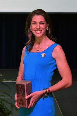 "Carie Wailgum, one of two Goodfellow spouses awarded, poses with her award after being recognized as one of San Angelo's ""20 under 40"" at the C.J. Davidson Conference Center in San Angelo, Texas, Nov. 30, 2018. Wailgum received her award for her work at West Texas Rehabilitation Center, which provides outpatient care to those in need, as well as her work within Hiring Our Heroes' Professional Network on Goodfellow Air Force Base. (U.S. Air Force photo by Airman 1st Class Zachary Chapman/Released)"