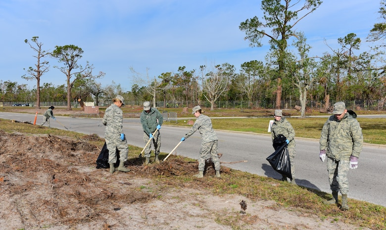 Task Force Talon II Airmen remove debris from the roadside at Tyndall Air Force Base, Fla., Nov. 29, 2018. Task Force Talon II is responsible for clearing debris and cleaning various parts of the base to include parts of the flightline and dormitories. (U.S. Air Force photo by Senior Airman Cody R. Miller)