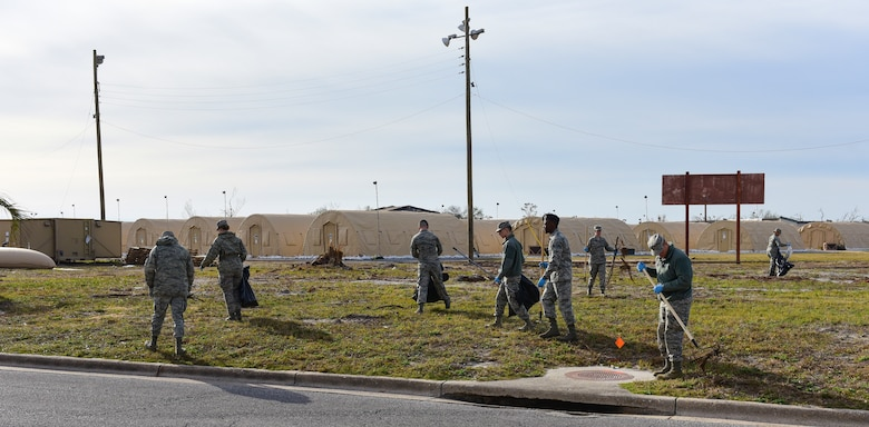"Task Force Talon II Airmen remove debris from the ""tent city"" at Tyndall Air Force Base, Fla., Nov. 29, 2018. Task Force Talon II is responsible for clearing debris and cleaning various parts of the base to include parts of the flightline and dormitories. (U.S. Air Force photo by Senior Airman Cody R. Miller)"