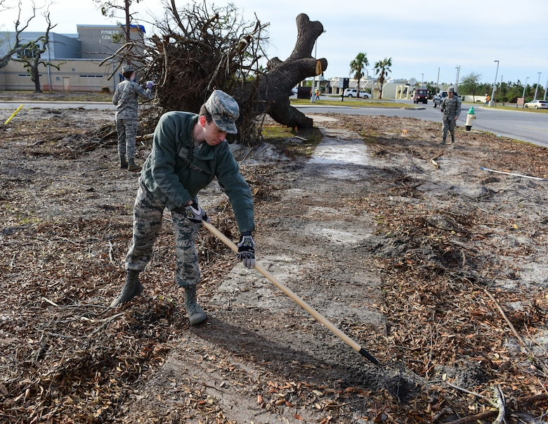 Airman 1st Class Cooper Russell, 337th Air Control Squadron weapons systems technician, rakes debris from the sidewalk as part of Task Force Talon II at Tyndall Air Force Base, Fla., Nov. 29, 2018. Task Force Talon II is responsible for clearing debris and cleaning various parts of the base to include parts of the flightline and dormitories. (U.S. Air Force photo by Senior Airman Cody R. Miller)