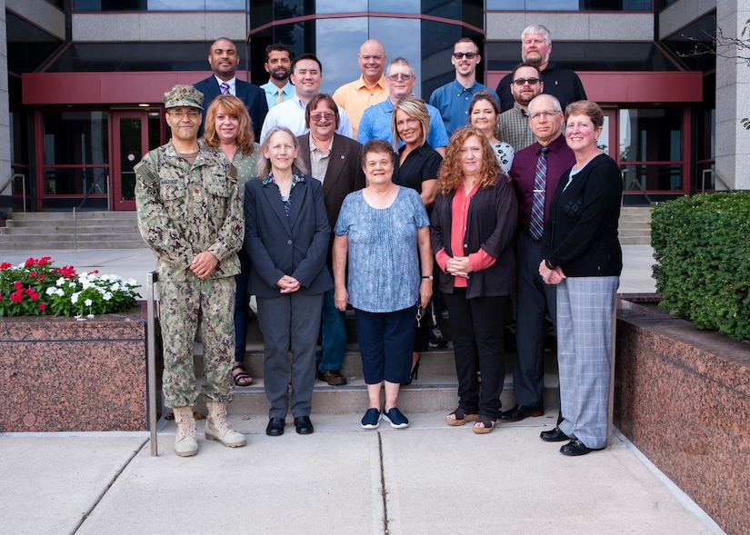 group picture of the Maritime Aircraft Launch and Recovery Equipment Team in front of building 20