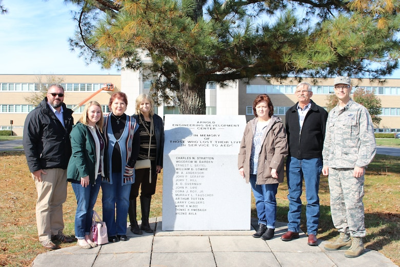 The family of the late Wilmer Adam Anderson, an AEDC concrete laborer, visited Arnold Air Force Base on Nov. 16 to see the memorial outside the Administration and Engineering Building that is dedicated to individuals who have lost their lives in service to AEDC. Anderson was among four AEDC team members who tragically lost their lives in an accident Dec. 17, 1962, at the J-4 liquid rocket test cell. Pictured left to right: Chris Warner, operations chief of AEDC Public Affairs; Julie Gesell; Bridgette Boner; Melissa Gesell; Marilyn Anderson Morton; Danny Anderson; and AEDC Commander Col. Cain. (U.S. Air Force photo by Deidre Ortiz)