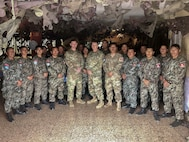 West Virginia Army National Guard (WVARNG) Master Sgt. Ricky Baker and Sgt. 1st Class Joshua Dunlap pose for a photo with members of the Peruvian Army following the completion of a Subject Matter Expert Exchange (SMEE) Global Peace Operations Initiative (GPOI) mission held in Lima, Peru, Nov. 26 – 30, 2018. The SMEE GPOI mission with the Peruvian Army helped to improve maintenance support for Peru's Training Center for Peace Operations upcoming mission to the Central African Republic and enhanced non-commissioned officer (NCO) development in their armed forces. (courtesy photo)