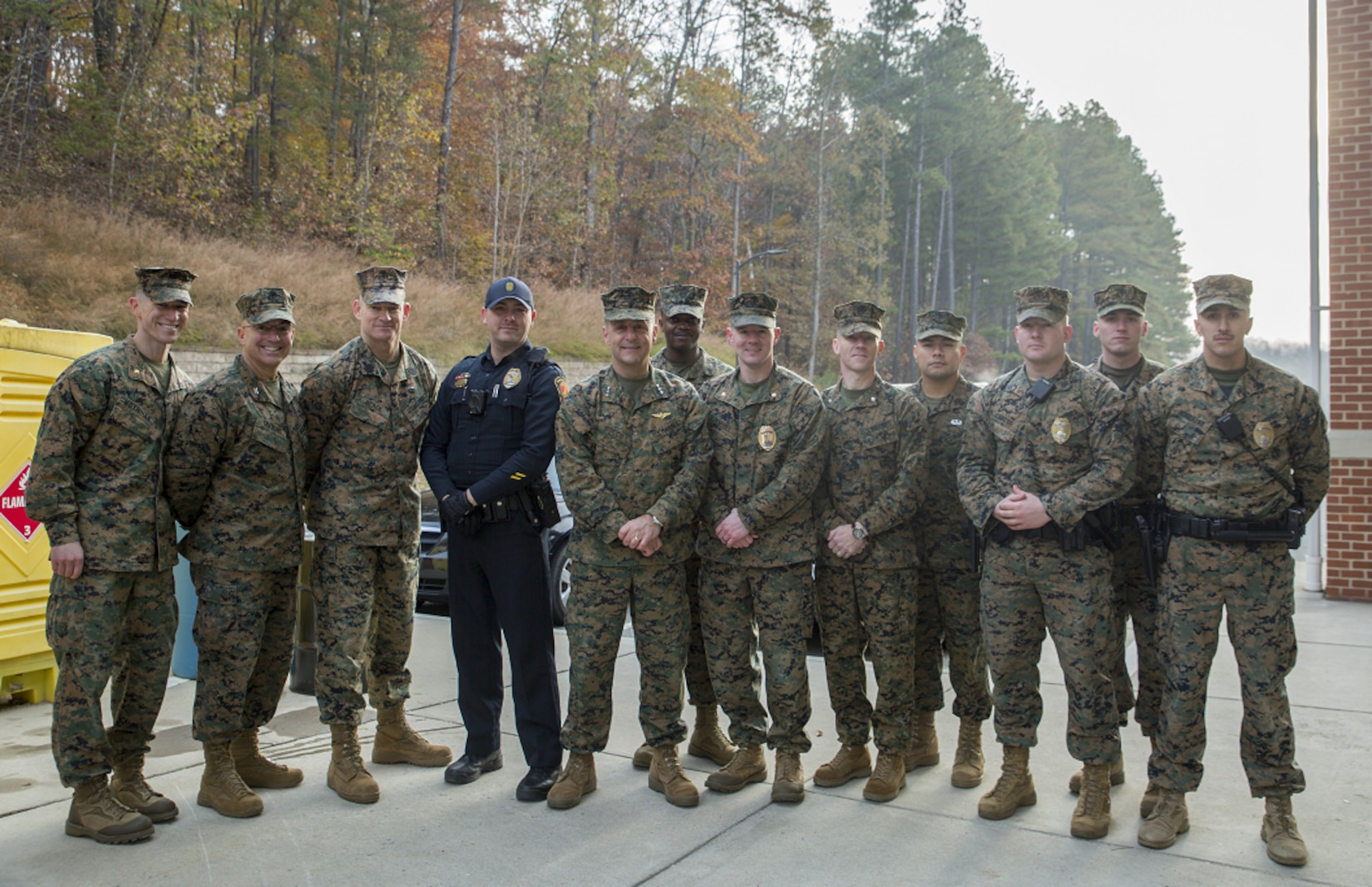 "Nov 19: Manpower & Reserve Affairs Commanding General, LtGen Rocco and SgtMaj Black standing with Marines and civilian officers from Security Battalion. Both the Commanding General and SgtMaj were greeting personnel aboard the installation and passing out ""Protect What You Have Earned"" cards at the gates prior to the Thanksgiving weekend."