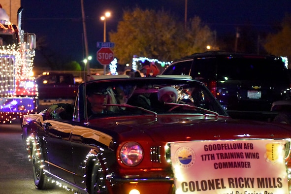 U.S. Air Force Col. Ricky Mills, 17th Training Wing commander, rides in a car during the 18th annual Lights of Christmas Parade in San Angelo, Texas, Dec. 1, 2018. Mills represented Goodfellow Air Force Base. (U.S. Air Force photo by Senior Airman Randall Moose/Released)
