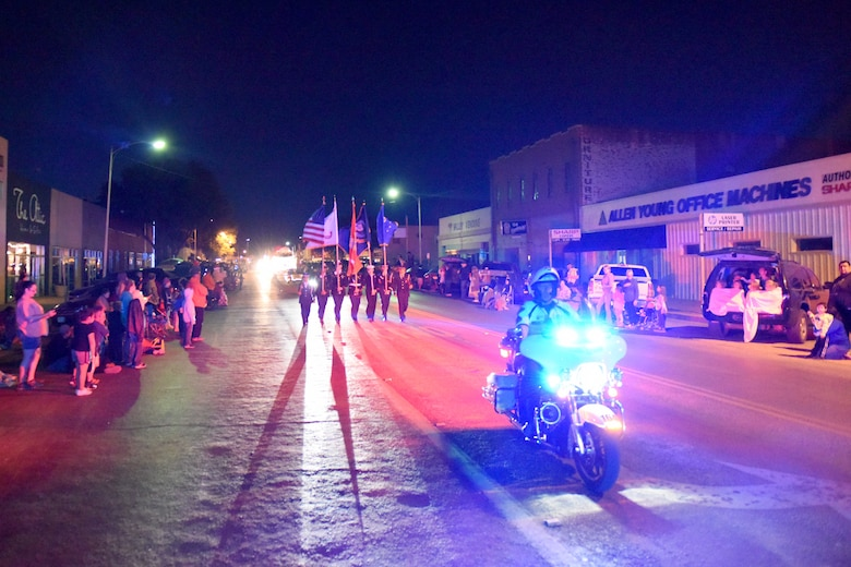 Goodfellow Air Force Base Joint Color Guard marches during the 18th annual Lights of Christmas Parade in San Angelo, Texas, Dec. 1, 2018. The San Angelo Police Department guided the parade through downtown San Angelo. (U.S. Air Force photo by Senior Airman Randall Moose/Released)
