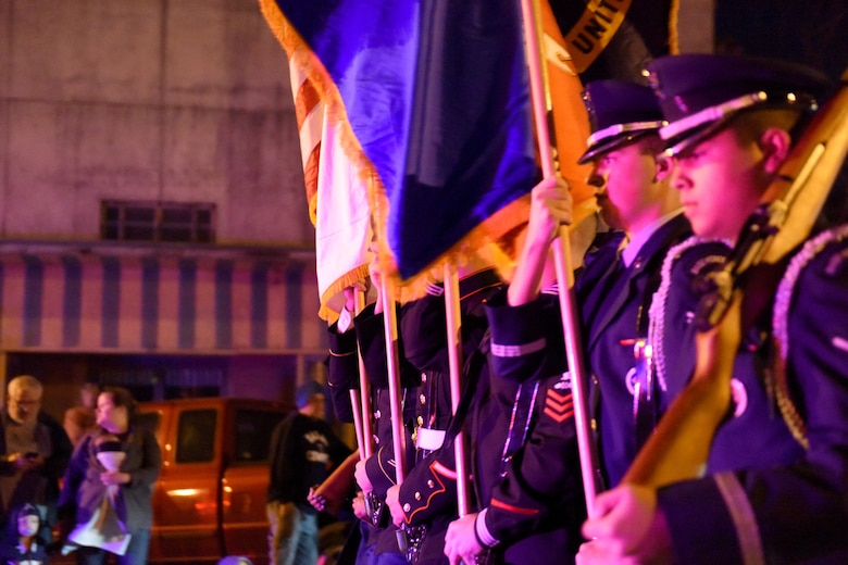 Goodfellow Air Force Base Joint Color Guard marches during the 18th annual Lights of Christmas Parade in San Angelo, Texas, Dec. 1, 2018. The Goodfellow color guard proceeded U.S. Air Force Col. Ricky Mills, 17th Training Wing commander, in the parade. (U.S. Air Force photo by Senior Airman Randall Moose/Released)