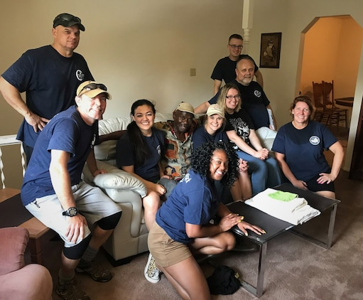 2nd Lt Michelle Burris and several other volunteers posed for a quick picture after setting up the furniture for a veteran who was recently placed into permanent housing.