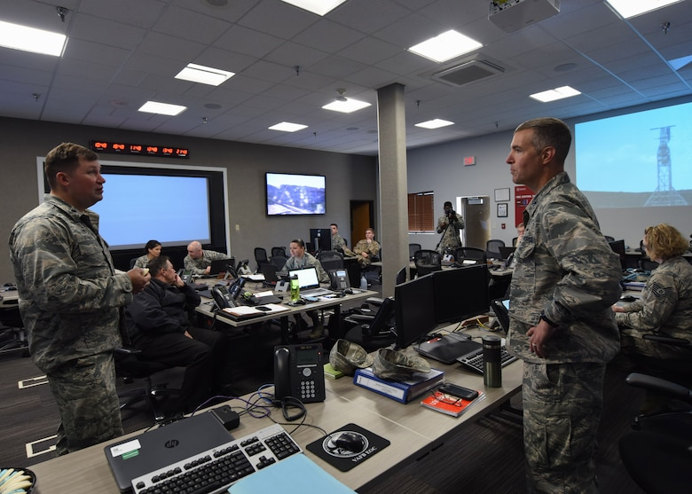 "Col. Michael Hunsberger, 30th Mission Support Group commander, and Lt. Col. Jason Aftanas, 30th Civil Engineer Squadron commander, discuss the post operations of the Spaceflight SSO-A: SmallSat Express on a SpaceX Falcon 9 rocket at the Emergency Operation Center, here, Dec. 3, 2018 at 10:34 a.m. ""The purpose of the Emergency Operations Center is to support the incident commander, who is typically the head of the Fire Department, with any needs they have if an incident were to occur,"" said Hunsberger. (U.S. Air Force photo by Airman 1st Class Aubree Milks/Released)"
