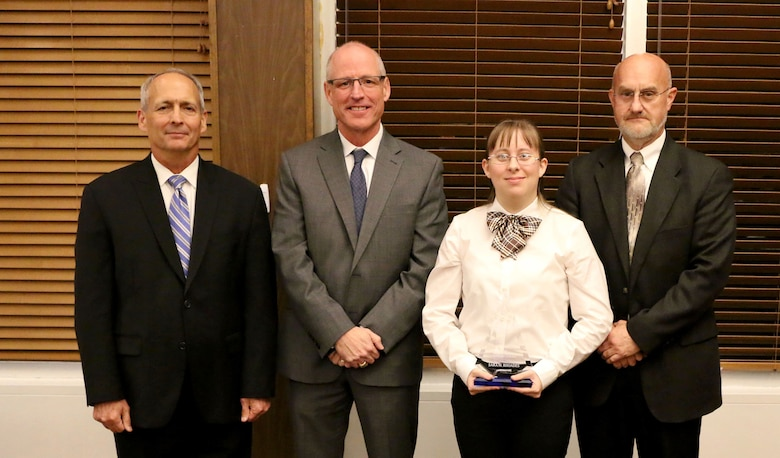 Facility Engineer/Scientist II Sara Rhoades (third from left) receives the Science and Technology Professional of the Year Award during the National Aerospace Solutions, LLC Salute to Excellence Annual Award Ceremony Nov. 14, 2018, at the Arnold Lakeside Center, Arnold Air Force Base, Tenn. Also pictured from left is NAS Deputy General Manager Michael Belzil, NAS General Manager Richard Tighe and NAS Technology Innovation Branch Manager Mark Brandon. (U.S. Air Force photo by Bradley Hicks)