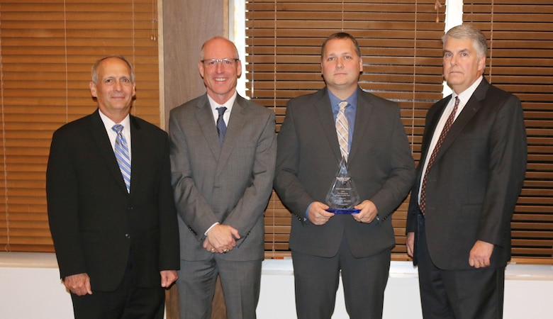 Senior Test Operations Engineer Ryan Allen (third from left) receives the Test Operations Engineer of the Year Award during the National Aerospace Solutions, LLC Salute to Excellence Annual Award Ceremony Nov. 14, 2018, at the Arnold Lakeside Center, Arnold Air Force Base, Tenn. Also pictured from left is NAS Deputy General Manager Michael Belzil, NAS General Manager Richard Tighe and NAS Test and Sustainment Engineering Manager Jeff Henderson. (U.S. Air Force photo by Bradley Hicks)