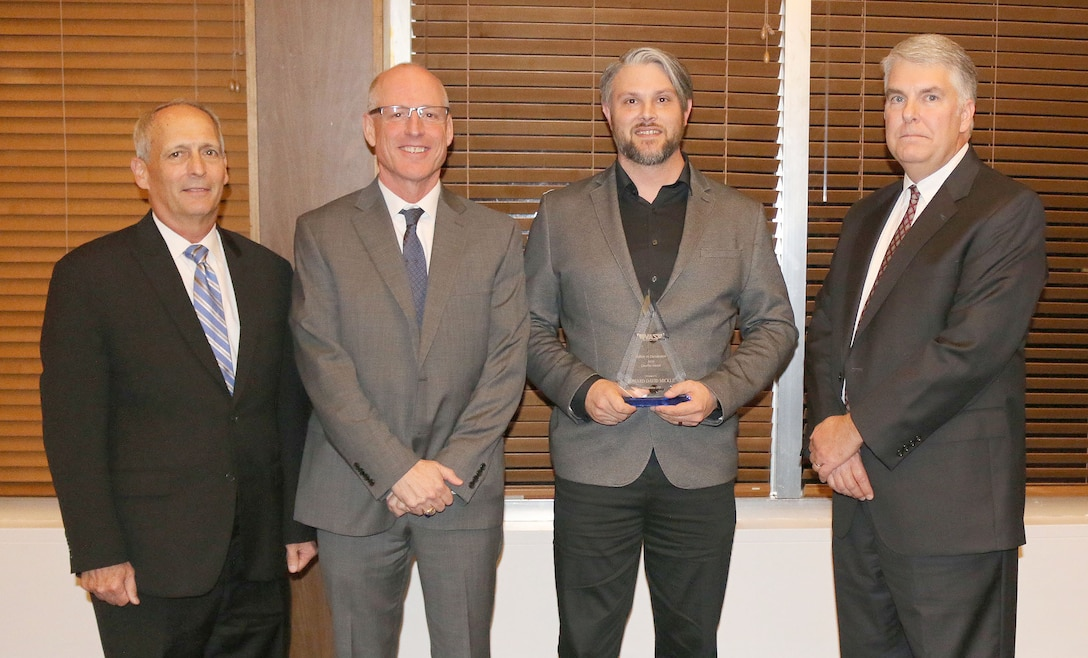 Acting Work Control Supervisor Edward D. Mickle (third from left) receives the Quality Award during the National Aerospace Solutions, LLC Salute to Excellence Annual Award Ceremony Nov. 14, 2018, at the Arnold Lakeside Center, Arnold Air Force Base, Tenn. Also pictured from left is NAS Deputy General Manager Michael Belzil, NAS General Manager Richard Tighe and NAS Test and Sustainment Engineering Manager Jeff Henderson. (U.S. Air Force photos by Bradley Hicks)
