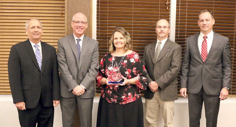 Technical Specialist Constance Rogers (third from left) receives the Customer Service Excellence Award during the National Aerospace Solutions, LLC Salute to Excellence Annual Award Ceremony Nov. 14, 2018, at the Arnold Lakeside Center, Arnold Air Force Base, Tenn. Also pictured from left is NAS Deputy General Manager Michael Belzil, NAS General Manager Richard Tighe, Chugach Base Operations - Utilities Manager Michael Harvey and NAS Business Services Director Chris Baker. (U.S. Air Force photo by Bradley Hicks)