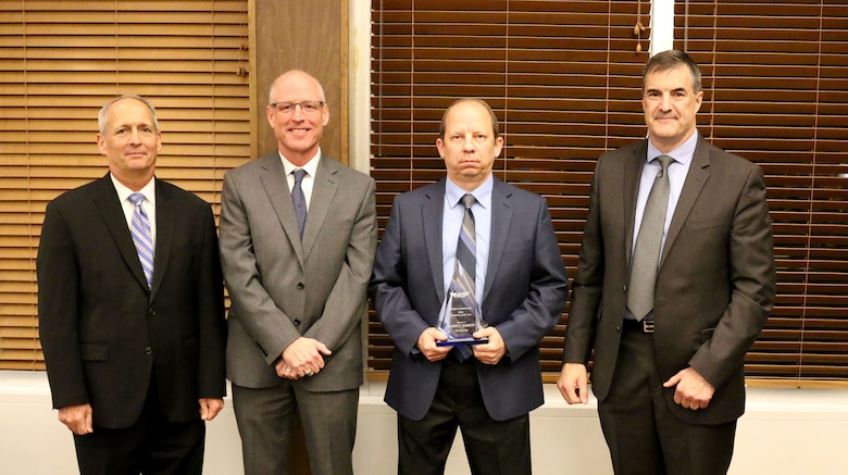 Outside Machinist Danny C. Haddon (third from left) receives the Technician of the Year Award during the National Aerospace Solutions, LLC Salute to Excellence Annual Award Ceremony Nov. 14, 2018, at the Arnold Lakeside Center, Arnold Air Force Base, Tenn. Also pictured from left is NAS Deputy General Manager Michael Belzil, NAS General Manager Richard Tighe and NAS Mission Execution Director Roderick Cregier. (U.S. Air Force photo by Bradley Hicks)
