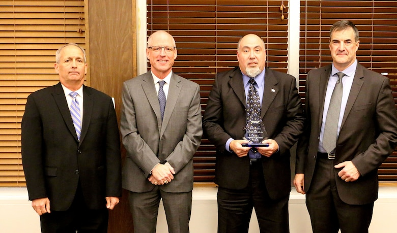 Precision Machining Supervisor Robert Williams (third from left) receives the Craft Supervisor/Superintendent of the Year Award during the National Aerospace Solutions, LLC Salute to Excellence Annual Award Ceremony Nov. 14, 2018, at the Arnold Lakeside Center, Arnold Air Force Base, Tenn. Also pictured from left is NAS Deputy General Manager Michael Belzil, NAS General Manager Richard Tighe and NAS Mission Execution Director Roderick Cregier. (U.S. Air Force photo by Bradley Hicks)