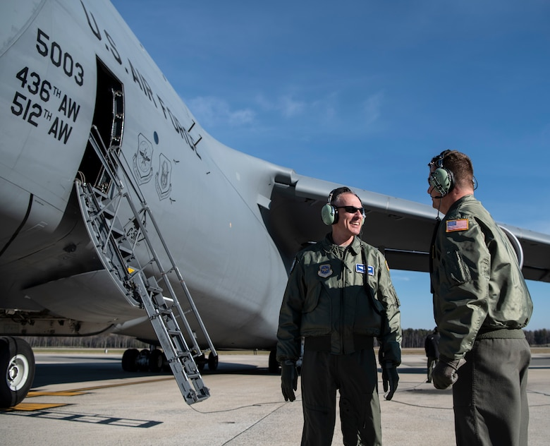 Chief Master Sgt. Larry C. Williams, Air Mobility Command command chief, speaks with Chief Master Sgt. Stephen West, 709th Airlift Squadron chief flight engineer, prior to takeoff on his final flight in a C-5M Super Galaxy Nov. 29, 2018, at Dover Air Force Base, Del. During the flight, the aircrew performed two touch-and-go's as well as  in-flight refueling with the 916th Air Refueling Wing, Air Force Reserve Command, Seymour Johnson Air Force Base, N.C. (U.S. Air Force photo by Airman 1st Class Zoe M. Wockenfuss)